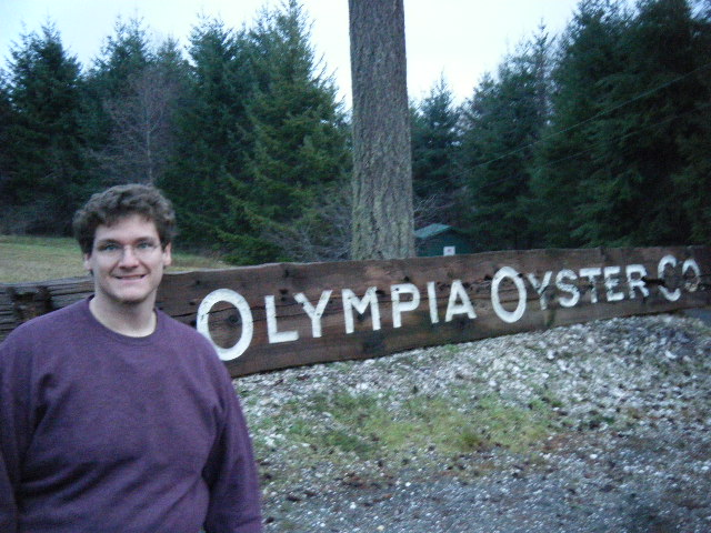 Intrepid Scientist at Olympia Oyster Company sign.